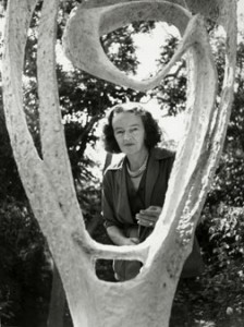 Barbara Hepworth with the plaster of 'Garden Sculpture' (Model for Meridian), BH 246, 1958, in her St Ives garden, June 1960; sourced from http://barbarahepworth.org.uk/biography/.